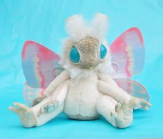 This is the curly mof, so called for his lovely curly ruff! He has delicate pastel wings made using my new cotton technique. Desu Desu, Pokemon, Kawaii Plush, Dinosaur Stuffed Animal, Stuffed Animals, Stuffed Toys, Soft Heart, Polymer Clay Creations, Doll Maker
