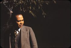 "From article by Darrly Pinckney ""Countee Cullen: The Reluctant Lamb"": Harlem Renaissance poet Countee Cullen in Central Park, New York. 1941 Photograph by Carl Van Vechten. Copyright Yale Collection of American Literature, Beinecke Library/Van Vechten Trust pinckney_1-032113.jpg"