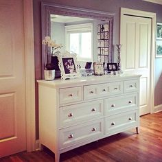 Dresser with mismatched mirror.