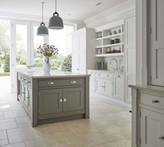 Grey shaker kitchen featuring the latest cutting-edge Miele appliances. Statement island and hidden storage solutions in this modern shaker kitchen.
