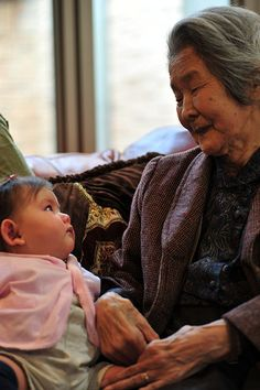 Adoration . Japan         Ivy and her Great-grandmother. Ivy is five months old. Great-grandma is 93. It is said that the youngest and oldest of us are the closest to God. Hence, the name of this photo: Closest to God.