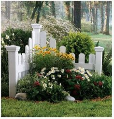Gorgeous way to have a little corner garden in your yard! You can make the fence from reclaimed wood, barn wood, old picket....possibilities are endless!
