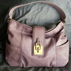 MICHAEL KORS Lavendar Lilac Leather bag Michael kors bag in lavendar lilac shade. The highly sought after color is perfect for spring and summer. This is a pre owned bag in gently used condition. Please see photos. There are no holes, stains or rips.  There are scratches on the gold tone hardware. The interior is clean.   Measurements  12 inches long  10 inches tall 4 inches wide 8 inch strap drop MICHAEL Michael Kors Bags Shoulder Bags