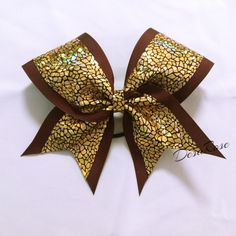 Shattered Glass Maroon and Gold Cheer Bow~ Sports Bow by DesaRoseBowtique on Etsy https://www.etsy.com/listing/223080601/shattered-glass-maroon-and-gold-cheer