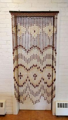 Nut and Bead Hippie Beaded Curtain - Ya gotta love the 60s. #hippie #curtain #etsy
