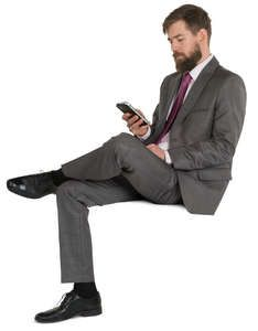 A man in a fancy suit sitting and texting People Cutout, Cut Out People, Body Reference Poses, Sitting Poses, Man Sitting, Render People, Fancy Suit, Sports Uniforms, Figure Sketching