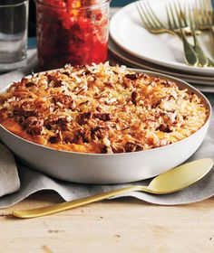 Sweet Potato Casserole With Coconut - Ingredients: 3lbs sweet potatoes, peeled and cut into 1-inch pieces - kosher salt - 1 cup sweetened shredded coconut - 1/2  cup packed light brown sugar - 1/2 cup chopped pecans - 1/2 cup granulated sugar - 1/3 cup whole milk - 1/2 cup (1 stick) unsalted butter, cut into pieces - 3 large eggs - 1 tsp pure vanilla extract.  See link for directions.