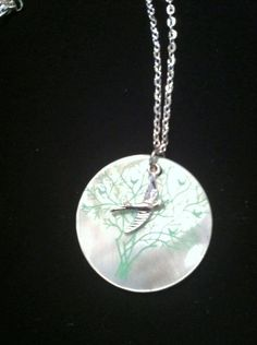 "Bird and oyster shell tree necklace. On 16"" silver coloured chain $18"