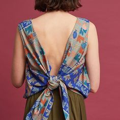 Azari Knotted Back Tank. In summer we love bows, bows on all our tops. A collaboration between Spanish fashion houses Ailanto and Trucco, this capsule collection is the embodiment of the Mediterranean summer, with bright prints and airy silhouettes meant for sun-filled days and breezy nights