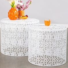 A stylish canvas for fresh bouquets or your after-work cocktail, this chic table brings a contemporary touch to your d�cor.   Product: Small and large side tableConstruction Material: IronColor: WhiteFeatures:  For indoor and outdoor usePerfect as a side table or extra stool Dimensions: 16 H x 19.5 Diameter (large)