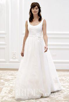A scoop-necked @annebargebride wedding dress with a belt | Brides.com