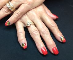 Red gel nails with sunflower nail art
