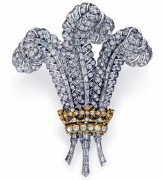THE PRINCE OF WALES BROOCH A DIAMOND BROOCH Designed as a plume of three circular-cut diamond feathers signifying the Prince of Wales, with baguette-cut diamond spines, gathered by a circular and single-cut diamond crown, mounted in platinum and gold, circa 1935 . Purchased by Elizabeth Taylor from Sotheby's, Geneva, April 2, 1987