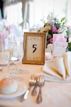 Ideas for Table Names and Numbers , Wedding Reception using picture frames to hold the table name/ number