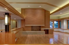 Two Red Colonial Thin Brick (Norman size) fireplaces compliment the full brick exterior of this custom home which was inspired by Frank Lloyd Wright's prairie-style Wingspread residence nearby. brick, thin brick, interior brick, brick fireplace, red brick, glengery, glen gery brick