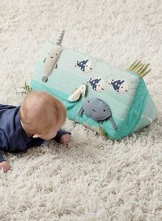 This tummy time toy is sure to get your little one's curiosity flowing. It's brimming with deep-sea surprises, from a hidden lobster and a rattling fish to a squeaky stingray. Pair it with our Be On the Sea Baby Activity Mat to create an underwater adventure that can be enjoyed from the comfort of the nursery.