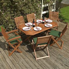 Wooden Garden Furniture Set - 6 Seater Folding Dining Set - This 7 Piece Table & Chairs Set Is The Perfect Outdoor Living Addition To Your Patio, Made From FSC Certified Eucalyptus Hardwood *Includes 6 Green Seat Cushions* Wooden Dining Set, 7 Piece Dining Set, Outdoor Dining Set, Patio Dining, Outdoor Living, Dining Sets, Outdoor Sofa, Dining Chairs, Wooden Garden Furniture