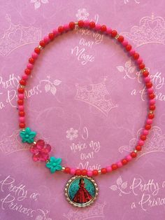 Elena of Avalor Stretch Necklace by GraceandGreenBeans on Etsy https://www.etsy.com/listing/466824738/elena-of-avalor-stretch-necklace