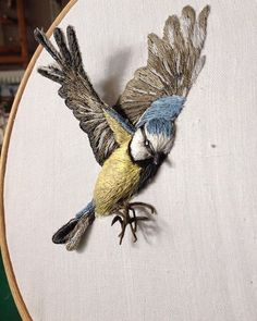 This amazing piece of Embroidery is bysarahjperrydesigns . The dimensional aspect of this piece is breath taking. It really captures the bird in flight!
