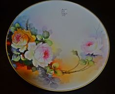 This is a hand painted Noritake (Morimura) plate dated by makers mark as early Nippon. It has a beautiful cream and sky blue background, with a spray of flowers in white, pinks and peach colours. Antique dealers tag still on. Peach Colors, Colours, Vintage Plates, Noritake, China Patterns, Fine China, Makers Mark, Blue Backgrounds, Hand Painted