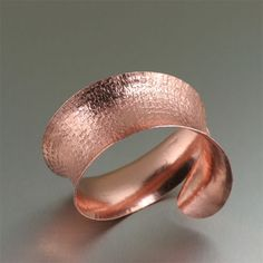 This #anticlastic handcrafted #copper #cuff bracelet is sure to make a statement.  Simply stunning, this bracelet features a deep textured pattern on the outside, complemented by a highly polished finished on the interior. $180