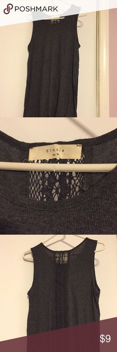 Grey tank with pretty lace back Barely worn grey tank with lace accent in the back Elodie Tops Tank Tops