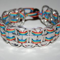 Rainbow Pop Can Tab Bracelet with Thin Ribbon. An awesome pop can tab bracelet with rainbow ribbon and a black pony bead closure. A bead closure makes this bracelet easy to put on and take off, but will stay put while you're wearing it!on Etsy. Pop Tab Crafts, Cute Crafts, Crafts To Make, Diy Crafts, Recycled Crafts, Teen Crafts, Recycled Clothing, Recycled Fashion, Can Tab Bracelet