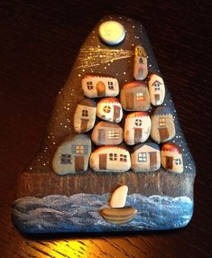 Seaside houses painted on stones with a sailboat in the ocean, stone art Pebble Painting, Pebble Art, Stone Painting, Rock Painting, Stone Crafts, Rock Crafts, Pebble Stone, Stone Art, Rock And Pebbles