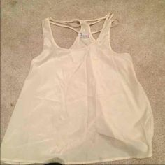 Sheer tank top Size large sheet tank top with back detail. It is snug in the chest area. Never worn Tops Tank Tops
