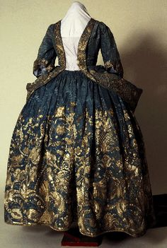 Silver embroidered blue damask court mantua (an open fronted gown with an…