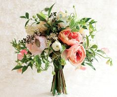 417 Bride To create a sense of softness, Phillips added in Icelandic poppies, sunset garden roses, pink blush peonies, coral sweet peas, snow drop hyacinth blossoms, poppies, white star gazer lily buds, Italian ruscus and seeded eucalyptus