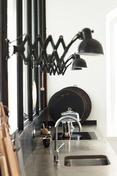 Industrial kitchen / scissor lamps. A former factory becomes a fabulous family home. Credit: Petra Reger / Wertvoll Fotografie.