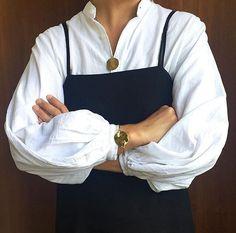 Celeste Tesoriero | White blouse shirt top | Straps | Apron| Medallion