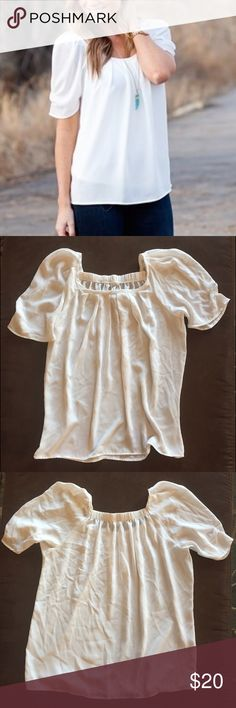 NWOT Ivory Blouse Size L Trendy and flattering blouse. Slightly puffy sleeves. Pleated scoop neck. Lightweight, comfy chiffon material. Size large (8-12). Never worn, like new. Tops Blouses