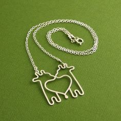 Twin Giraffe Necklace, Sterling Silver, Cable Chain, Made To Order. $65.00, via Etsy. --  so cute! i'm not super into giraffes (like owls) but these are cute :)