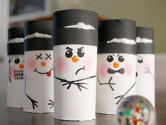 Snowman Bowling ~ all you need to make this fun winter craft are six toilet paper tubes, some paint, markers, black cardstock and glue, plus some kind of ball that rolls.
