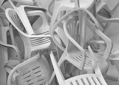 WHITE BILLION CHAIRS (2002/2009)  What's the monobloc chair worth? Can you add substance to an industrial product by taking away material, bit by bit, hole by hole, eventually rendering its structure too fragile to support its traditional usage?