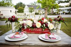 Reinvent this centerpiece w/ coke crates from Martha Claire's Market.  Ask to rent them for your event today!