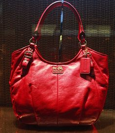 Red Handbag, Coach.  One thing I don't have is a red bag.