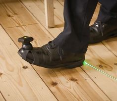 Path Finder is an innovative and award-winning assistive device that helps a user walk. The technology is especially aimed at users with Parkinson's Disease or other neurodegenerative disease who have difficulty walking, e.g. 'freeze of gait'. Pathfinder consists of 2 laser units, which are attached with rubber straps to each shoe and emit a clear green line in front of one foot, which is used to guide a user to step across the line, whereby a new line appears in front of the other foot. Parkinson's Disease, Freeze, Walking, The Unit, Technology, Beautiful, Boots, Fashion, Nun