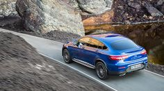 Rear view of the new Mercedes-Benz GLC Coupé on the road.