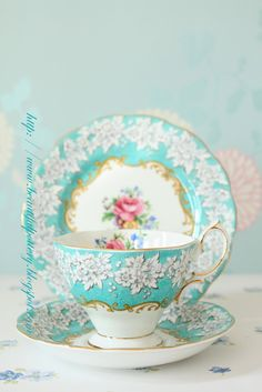{Royal Albert} Aqua and pink rose...looks so lacy  I love the use of color here, the mix of blue, gold and yellow has a really strong impact.