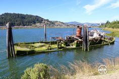 The remains of the over century old Mary D. Hume, half sunk in the Rogue River of Gold Beach, Oregon