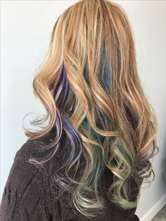Beautiful blonde balayage with cool fashion tones of blue green and purple ... Salon Aura located in Selden ny 632-320-3700 hair done by Kerri