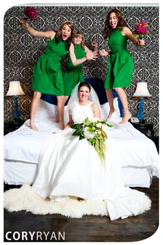 Fun bridal party portrait of bride and bridesmaids jumping on bed at Hotel St. Cecilia