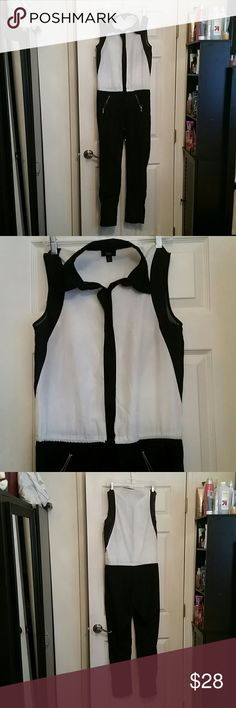 """One piece jumpsuit /button up top with collar Beautiful one piece jumpsuit / black and white color tone/ top is button up with hidden buttons and waist is with drawstring / 2 zipper pocket s at the front / skinny leg / great condition (there is a little marking in the front but not noticeable and haven't tried removing it , I'm sure oxyclean would do the job!) I'm a 34d bust 27"""" waist and this fits! Worn 1 time for a cpl hours Mossimo Supply Co Tops Button Down Shirts"""