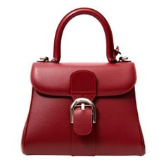 Delvaux Brillant Red MM.  Delvaux is a Belgium luxury bag company founded in 1829, predating both Louis Vuitton and Hermes.  Bag sold on First Dibs