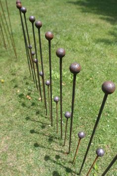 I could make these and a lot of them would have an awesome look! Gardens stakes - by battlehillforge on ETsY