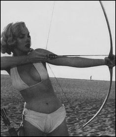 Archery with Marilyn Monroe - some of the other shots on the page are mildly NSFW