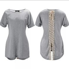 Gray short sleeve top READ DESCRIPTION FOR SIZE! Gray short sleeve top with flowers down the back and split at the bottom  THIS SHIRT RUNS SMALL. The measurements are armpit to armpit 15 inches. Waist 13.5 inches. Length 22.5 inches.   These are NWOT Retail. Price Firm Unless Bundled Tops Tees - Short Sleeve
